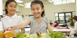Students reaching for healthy foods